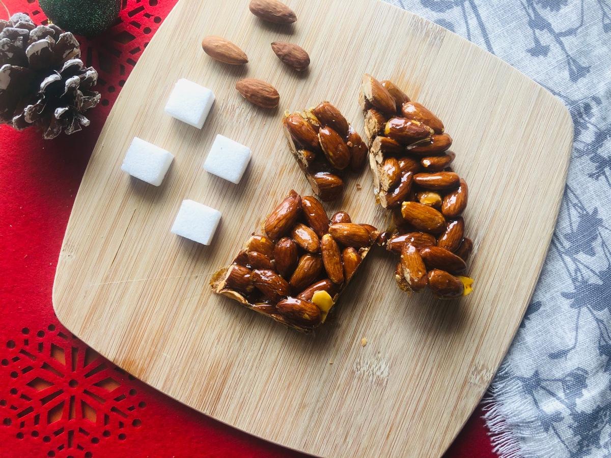 Almond brittle: torrone, cubaita or minnulata. Just two ingredients for a deliciousdessert.